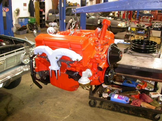 12_smallblock_Chevrolet_V8_remanufactured_engine_on_hoist