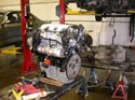 51_Chevrolet_minivan_rebuilt_V6_engine_on_workbench