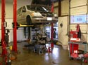 55_Chev_minivan_rebuilt_V6_engine_on_lift