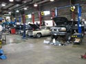 6_Ford_pickup_Cadillac_GMC_in_repair_shop