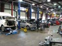 7_Ford_van_Chrysler_minivan_in_repair_shop