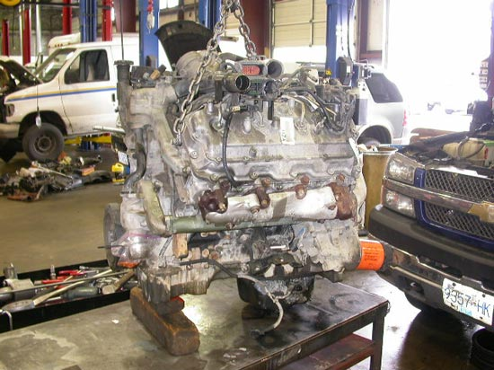 13_Chev_pickup_truck_engine_removed_on_hoist